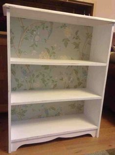 This bookcase was originally in plain pine and was old and tired. To give it a new lease of life, I sanded it down and painted in white. I then covered the back board with Laura Ashley Summer Palace wallpaper. I then sanded the corners to give it an authentic shabby chic look. And viola!!!