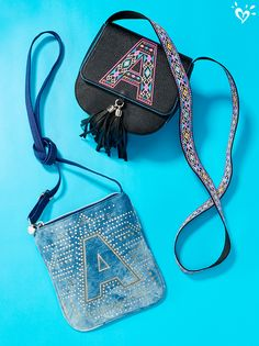 Details live here...as well as your fave lip gloss, we're sure. :-) Cool crossbody bags made extra special by an embellished personal initial.