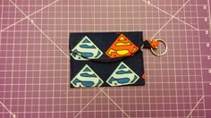Pattern designed by AiviloCharlotte Designs. Pouch, Wallet, Coin Purses, Superman, Pattern Design, Coins, Shop, Handmade, Accessories