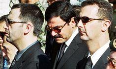 Bashar al-Assad (right), his brother Maher (left) and brother-in-law Asef Shawkat at the funeral of Hafez al-Assad. Photograph: Khaled Al-Ha...