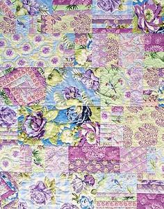 Amy Butler discusses how to make a reversible patchwork quilt. Purple floral front throw quilt. Love the fabrics.