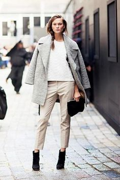 Winter Outfit Inspiration: Gray coat with oversized lapel, worn with khaki trousers and black booties.