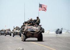 http://historyguy.com/GulfWar.html  American troops on the road to Kuwait City, Gulf War (1st Iraq War), 1991.