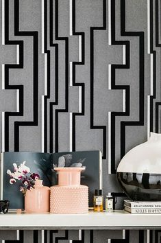 Modern Art and graphic design meet velvety flock. The black elements have been treated with micro-short viscose fibres, creating a tactile soft relief. Anthracite grey and silver shimmer add to the fantastic three-dimensionality. This flock wallpaper awakens the desire for unusual creative concepts. #interiorideas#wallcovering #wallcovering#homeinspiration