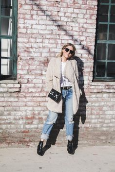 Faux fur coat with distressed boyfriend jeans