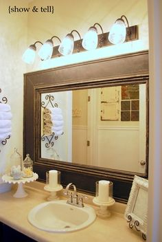 I love this framed builder's mirror for the bath.  I plan on framing our mirrors too (when Clay's isn't home, lol)
