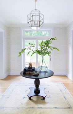 Round Black Entry Table on Ivory and Blue Rug - Transitional - Entrance/foyer Entryway Round Table, Black Entry Table, Foyer Table Decor, Black Round Table, Accent Table Decor, Black Accent Table, Entrance Table, Round Accent Table, Entry Tables
