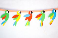 Learn how to make this Wild Parrot Garland with a free template and tute on the site today inspired by The Wild Life in theaters September Vbs Crafts, Preschool Crafts, Crafts To Make, Crafts For Kids, Paper Crafts, Parrot Craft, Bird Template, Vacation Bible School, Tropical Party