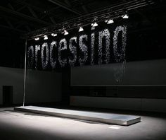 bit.fall by Julius Popp. Popp uses controlled drips of water to create a waterfall of words and images taken from the Internet.