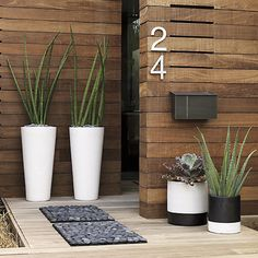 The concept of numbers in feng shui is a charged one. In considering the feng shui of your house, every little detail is important, including the numbers. Front Door Planters, Large Planters, Outdoor Planters, Plants For Front Door, Outdoor Walls, Modern Landscaping, Backyard Landscaping, Black Rock Landscaping, Decoration Entree