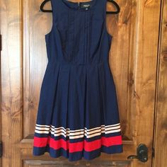 Blue Jason Wu fit and flare dress ***lowest price***Jason Wu for Target. Worn only a handful of times. Beautiful navy blue fit and flare with red and cream accents and a pleated skirt. True to size. Jason Wu Dresses