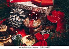 Christmas still life with ginger honey biscuits, ornaments, pine, wreaths,gift box and chocolate candy on a wooden background