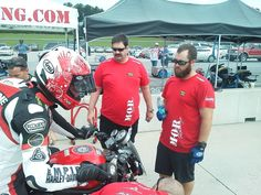 Veterans Empowered Through Motorsports crew members Stephen and Dallas (L to R) with AMA Pro Road Racing team M.O.B. Racing's Shane Narbonne during Sunday morning warm up in the Vance & Hines Harley-Davidson XR1200 Series at Barber Motorsports Park.