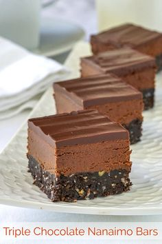 A triple chocolate version of the classic Canadian no bake treat that may well be one of the best chocolate cookie bars you've ever tasted. The post Chocolate Nanaimo Bars appeared first on Rock Recipes. Chocolate Cookie Bars, Cookie Brownie Bars, Melting Chocolate Chips, Best Chocolate, Christmas Chocolate, Chocolate Treats, Chocolate Orange, Delicious Chocolate, Nanaimo Bars