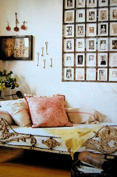 love the large group of small framed old photos and the French iron day bed