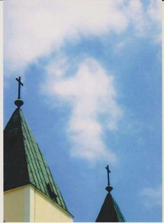 Figure in clouds above st james churches . Medjugorie today ...