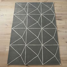 "<span class=""copyHeader"">fiber optic.</span> Geometric prisms illusion a 3D shattered effect in cream on grey.…"