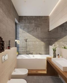 Stylish soft grey stone tiles and contemporary white bathroom!