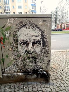 Street art portrait in Berlin, Germany by French artist Christian Guémy aka C215