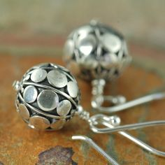 Flat disc Sterling silver Bali dangle earrings. $38.00, via Etsy.