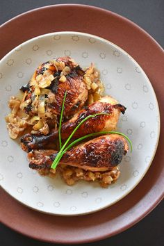 This easy and delicious Whole30-friendly recipe for roast chicken with caramelized shallots and a tangy vinegar sauce is one of my favorite weeknight meals!