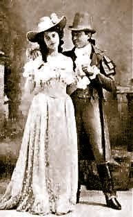 """Isabel Jay as Lady Rosie Pippin and Robert Evett as Terence in the original 1901 production of """"The Emerald Isle"""" at the Savoy Theatre."""