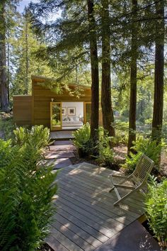 Sebastopol Residence by Turnbull Griffin Haesloop Architects. Designed for two graphic designers, this house bridges between two stands of redwood trees...