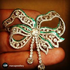 Gorgeous diamond and Emerald bow brooch