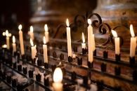 Vigil Candles Lit and Placed Amid Beautiful Cast Iron Candle Holders