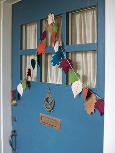Make this festive front door garland from an array of felt leaves in a stunning fall color palette. To re-create this design, add a running stitch in contrasting embroidery thread to each felt leaf cutout, glue leaves to twine, hang, and enjoy./