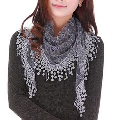 Your new go-to scarf for fall! This popular lace fringe shawl scarf comes in a variety of colors to pair with just about any outfit. Featuring a triangular shape, metallic details and a delicate lace trim, you'll love pairing this with sweaters and blouses for an extra layer of loveliness.