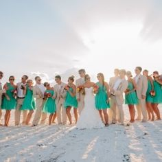 Bold colors of aqua and orange make this beach wedding really stand out!