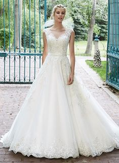 Bellissima - by Maggie Sottero - Available  Spring 2015, Sample Size 16, Ivory over Light Gold with Pewter Accents. Bridal Boutique, 2207 North Belt Hwy, Suite F, Saint Joseph, Missouri, 64506, 816-233-69456
