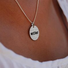 #writer charm necklace, $12