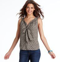 Dot Print Tie Neck Shell - Perfectly ruched and sprinkled with darling dots, a tie neck ups the flirt factor of this sweet shell. Split neck. Sleeveless. Ruched neckline with tonal ties. Back yoke with shirred detail. Rounded hem.