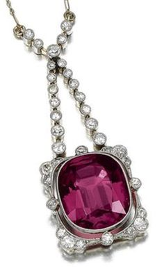 RUBELLITE AND DIAMOND PENDANT, CIRCA 1910. Centring on a cushion-shaped rubellite, to a frame millegrain-set with circular- and single-cut diamonds, to a fine fetter link chain, French assay and maker's marks. #BelleEpoque #antique #pendant