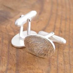 fingerprint cufflinks. perfect wedding-day gift for the groom from his soon-to-be spouse!