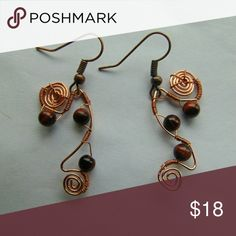 Handmade Copper Tigers Eye Earrings Hand woven copper wire earrings with tigers eye stone centerpieces. Earrings are approximately 2 1/4 I inches long. Jewelry