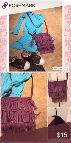 🎈Purple fringe girly pocketbook🎈 Purple fringe boho style pocketbook. Can be worn cross body or at shoulder. Has a zipper closure, open space inside w two slit pockets. Excellent condition. Accessories Bags