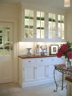 glass cabinet, wood counter, baseboard