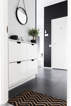 IKEA Nordli shoe storage in front hall functions also as drop zone/console table. IKEA Nordli shoe storage in front hall functions also as drop zone/console table. Shoe Storage Cabinet, Ikea Shoe Cabinet, Storage, Black Bathroom Storage Cabinet, Ikea Storage Cabinets, Black Bathroom Storage, House Interior, Contemporary Home Decor, Traditional Decor