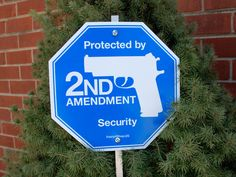 """Our popular 2nd Amendment logo is now on a security yard sign. Deter would-be intruders with our """"Protected by 2nd Amendment Security"""" sign made out of white polyethylene that won't chip or crack in harsh environments."""