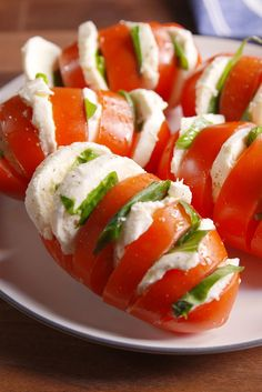 Best Caprese Tomatoes Recipe - How to Make Caprese Salad - Delish.com--Class up tomato-and-mozz salad with this hasselback technique.