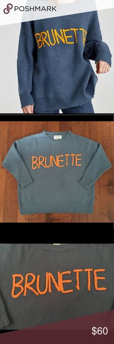 """""""BRUNETTE"""" blue knit sweater Are you a """"BRUNETTE""""? (Or not) Well then this is the perfect top for you!! A super cozy blue knit sweater with distressed neckline. Across the chest is embroidered """"BRUNETTE"""" in orange. Layer over a shirt, throw on with a pair of jeans or leggings...perfect weekend look! Brand new. Size M 🚫trades Sweaters"""