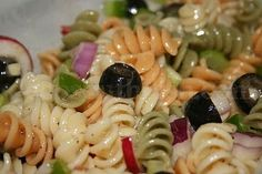 Tri-Color Italian Rotini Pasta Salad. Add Hearts of Palm, Chopped Green Onion, Avo, Cherry Tomatoes, Artichoke Hearts and Olives as the base, Smother in Newman's Light Italian Dressing. For fun try adding crab and/or shrimp! Delish!