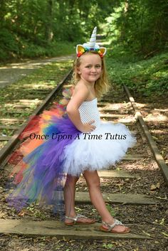 Bright Unicorn Tutu Dress This stunning bustle tutu dress is perfect for birthday parties, gifts, Halloween costumes, and dress up! It features bright rainbow colors throughout the mane and tail, and white (or your choice of color) in the front. The top is an unlined crochet tube
