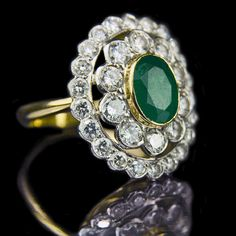 Oval emerald with double row brilliant cut diamond cluster