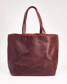 """DESCRIPTION    Whether you're flying west, booking it to class, or hauling all your kid's stuff around, Lori is your ultimate carry all. Handmade with soft and sturdy leather, Lori continues to look better with wear.   PRODUCT DETAILS    Dimensions: 19"""" x 13"""" x 7"""" Strap Height: 9"""" Easy Accessible Inside Pocket"""