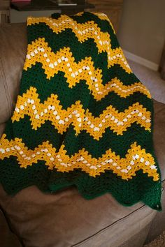 Go Pack Go! Support your favorite football team with this unique, hand crocheted blanket in green, gold and white. This awesome blanket is perfect for keeping warm while you watch the Packers play, and all through the football season. Add a bit of team spirit to your home decor or add an awesome finishing touch to your sports man cave! Size: 42 X 49 Blanket is made with 100% acrylic yarn and is hypoallergenic and machine washable.