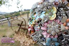 Pastel coloured wedding brooch bouquet by Nic's Button Buds